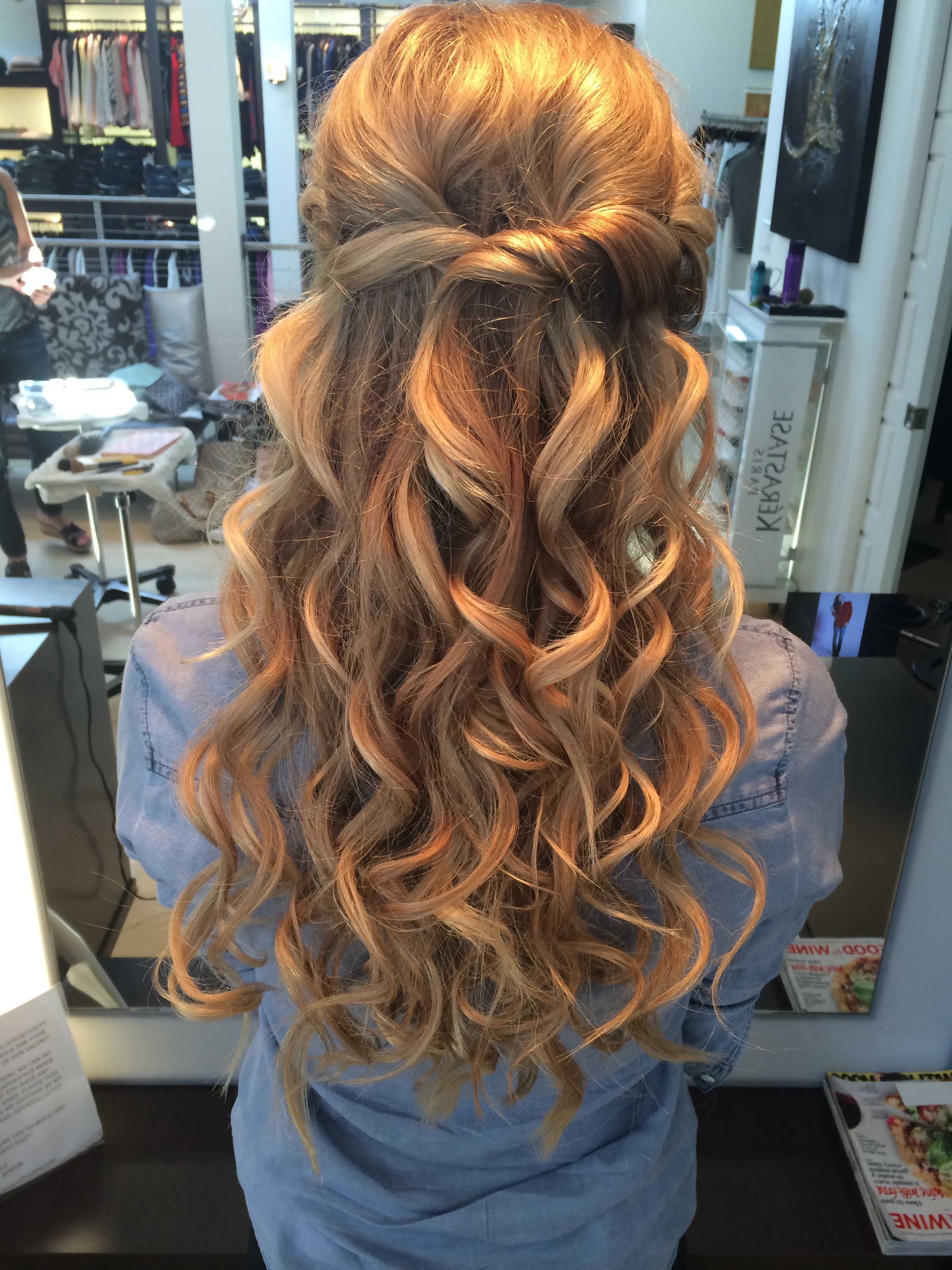 half up half down twisted hairstyle with big curls