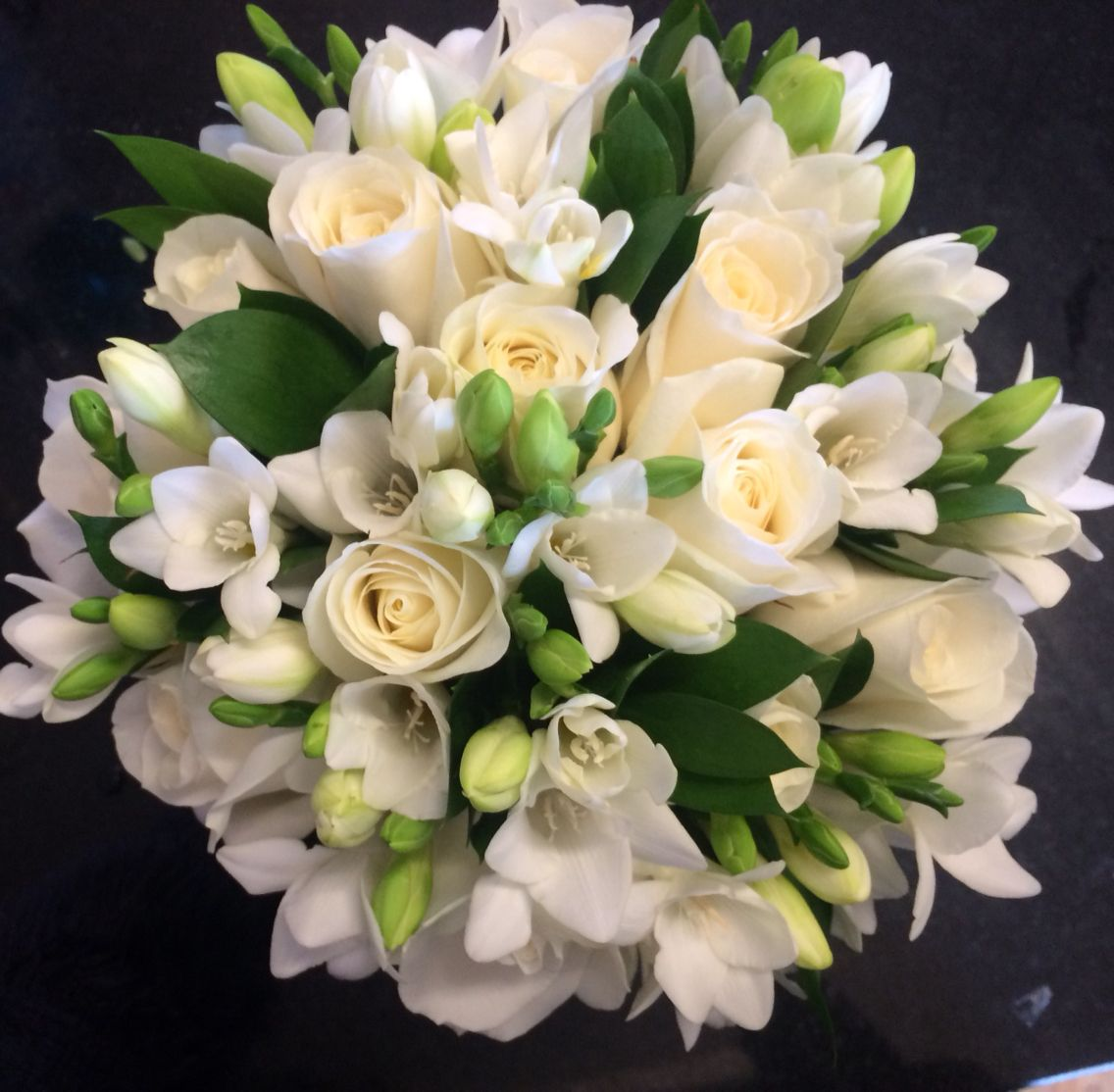 Roses freesia and ruscus pure white and green bouquet this brides roses freesia and ruscus pure white and green bouquet this brides wedding flowers bouquet izmirmasajfo