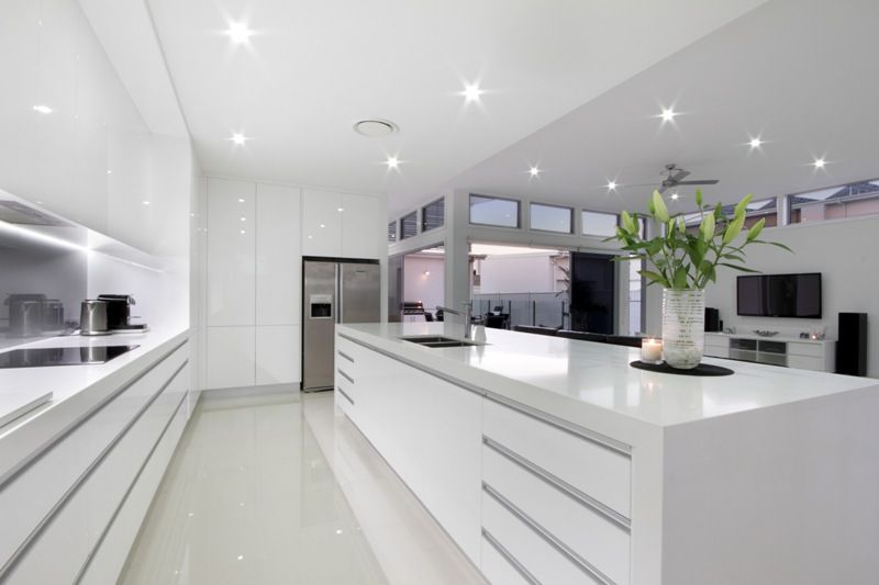 White Kitchen Black Benchtop white gloss cabinets, marble island bench, smoked mirror