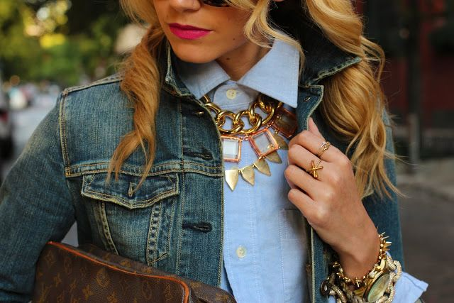 necklace over buttoned-up shirt