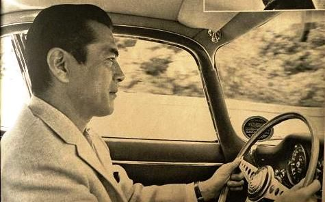 Toshiro Mifune driving (and showing off a perfect profile)