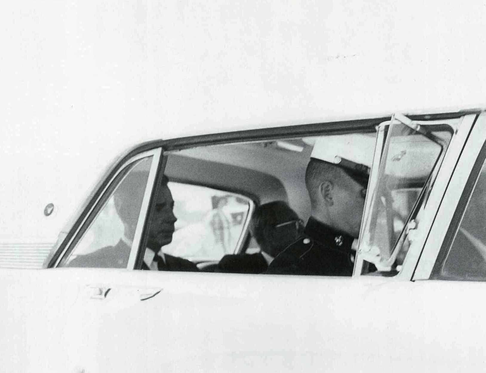 Joe dimaggio and his son leaving marilynus funeral august