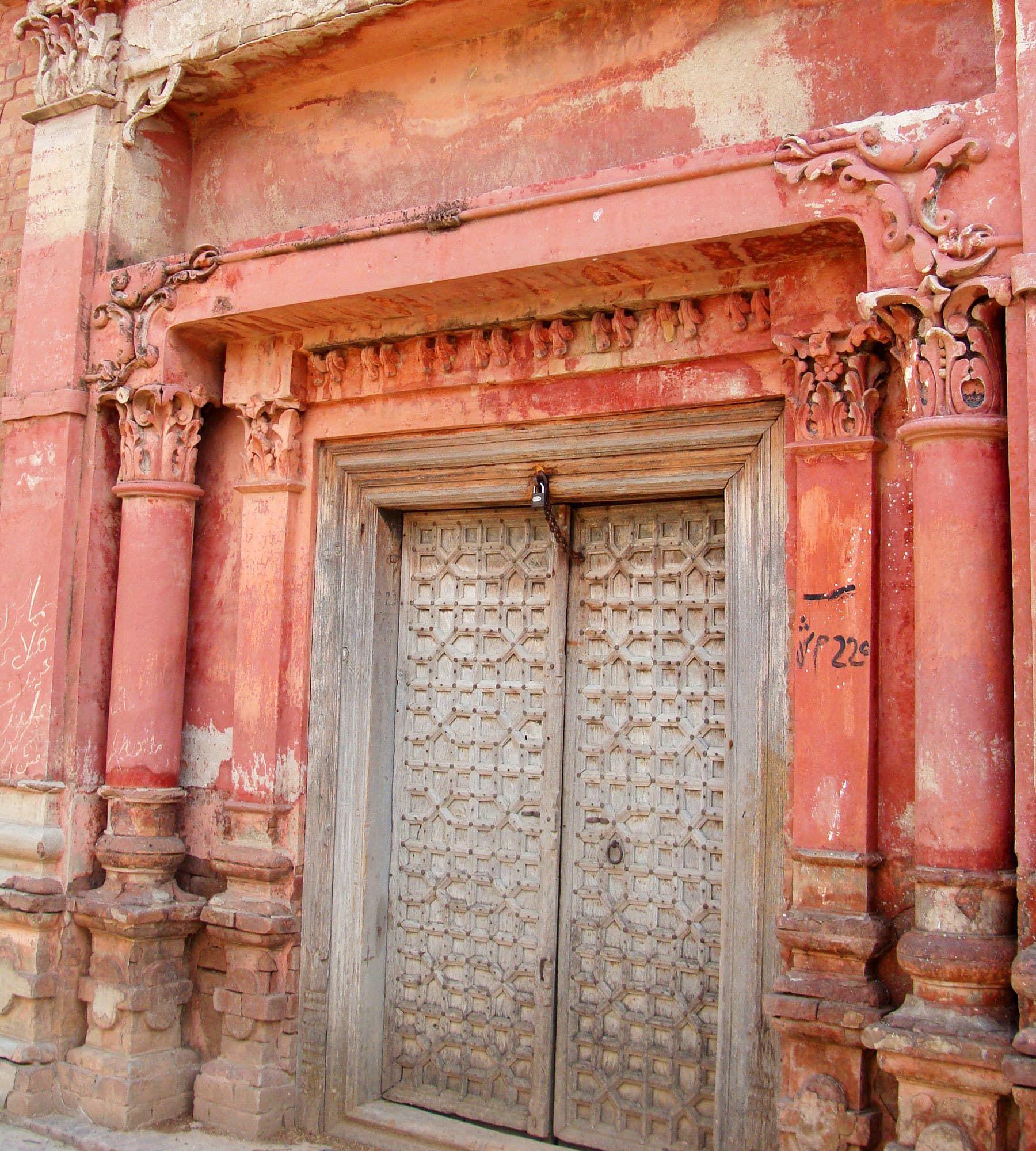 A carved wooden door in the tara singh haveli old for Wood doors in pakistan