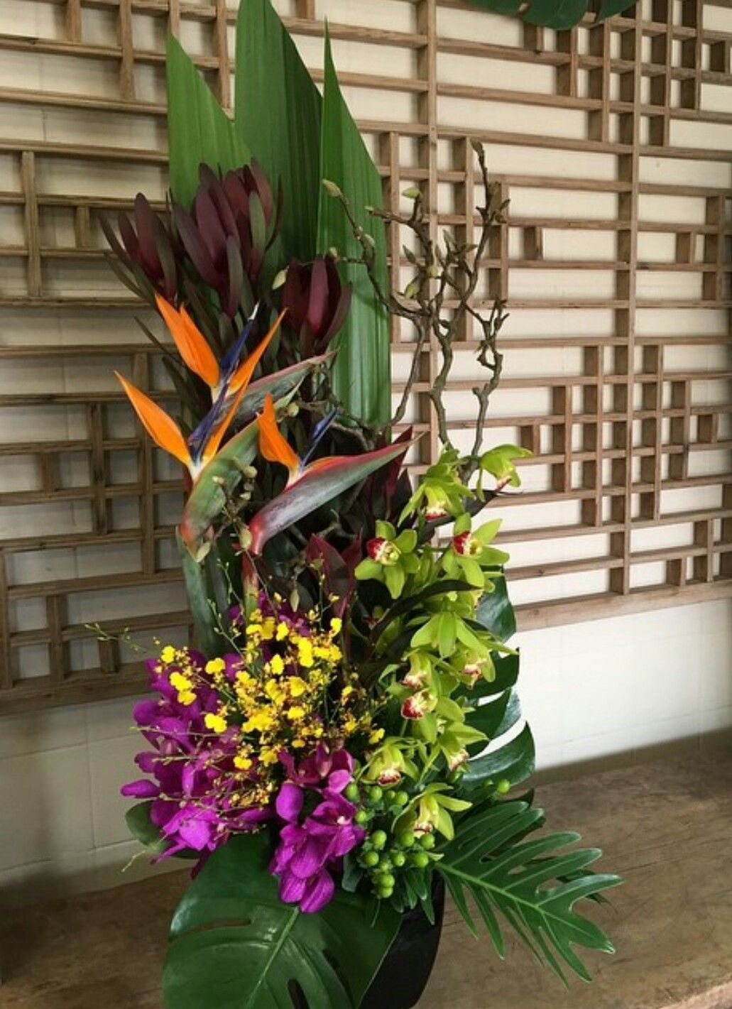 Beautiful tropical arrangement with birds of paradise and cymbidium