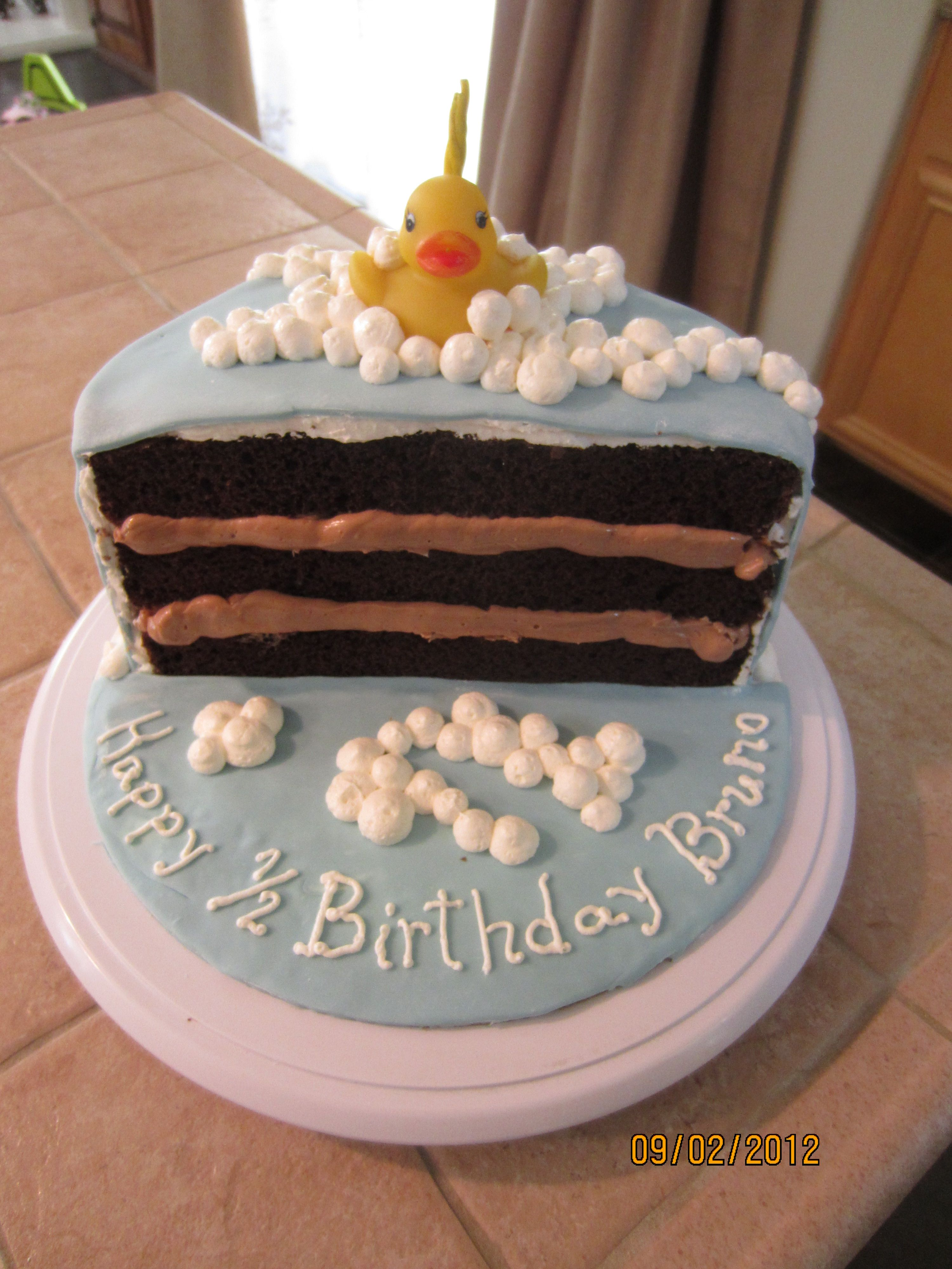 I Like How You Can See The Layers On Inside Of Cake Here And Writing In Front It