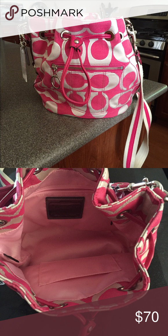 New pink Coach Absolutely no marks or damage. Used ONE time. Spacious inside with two straps. Perfect summer color! Coach Bags