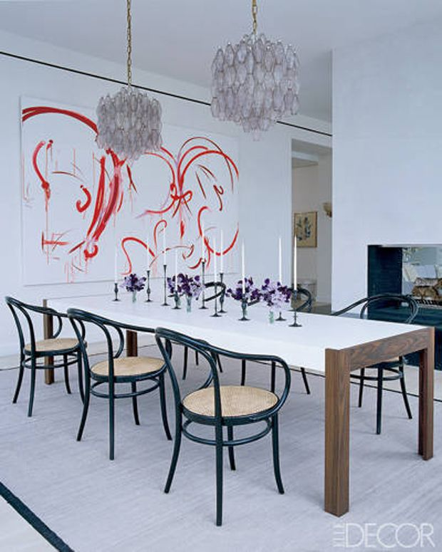 Dining room with Thonet chairs and abstract modern art.