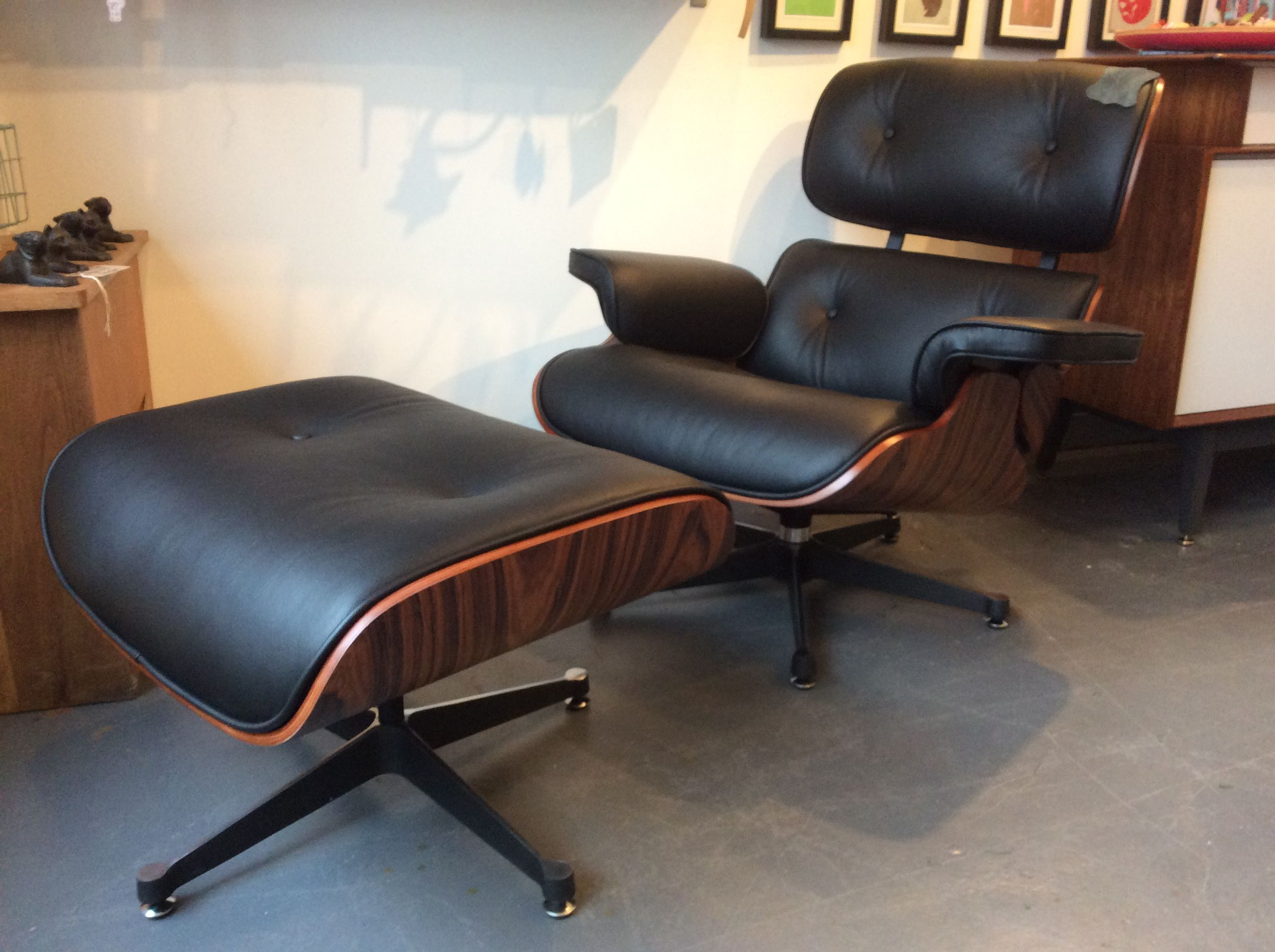 The Quintissential Modern Classic. Black Italian leather and Rosewood Lounge Chair & Ottoman, inspired by Eames, £800.00 at Kingdom Furnishings#interiordesign #homewares #vintagefurniture #midcentury