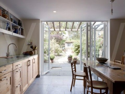 Kitchen looking out to garden love the accordion glass for Terrace kitchen garden ideas