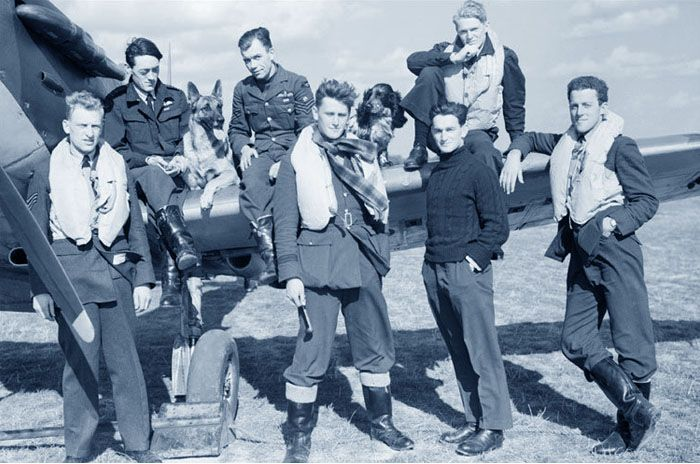 Royal Air Force fighter pilots of 16 and 19 Squadron seem to exude relaxed and youthful elan despite the strains of the Battle of Britain which they were presently fighting. Flight Sergeant Grumpy Unwin DFC sits between squadron mascots Flash the Alsation and Rangy the Spaniel. Photo: Imperial War Museum, Duxford
