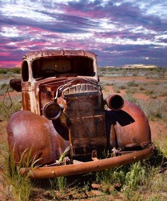A rusty old pick-up truck sits derelict in a field Stock Photo - 10779193
