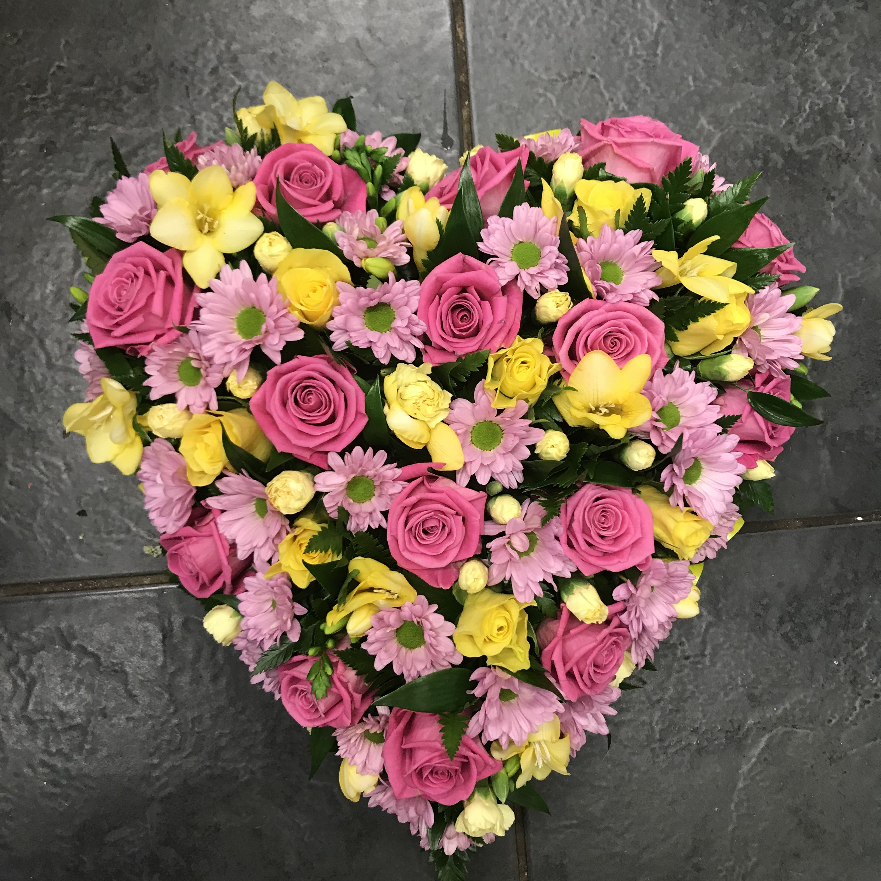 Yellow And Pink Loose Filled Heart Funeral Tribute With Roses
