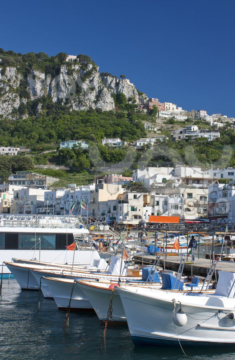 Boats in the summer sun in the port of Capri, Italy