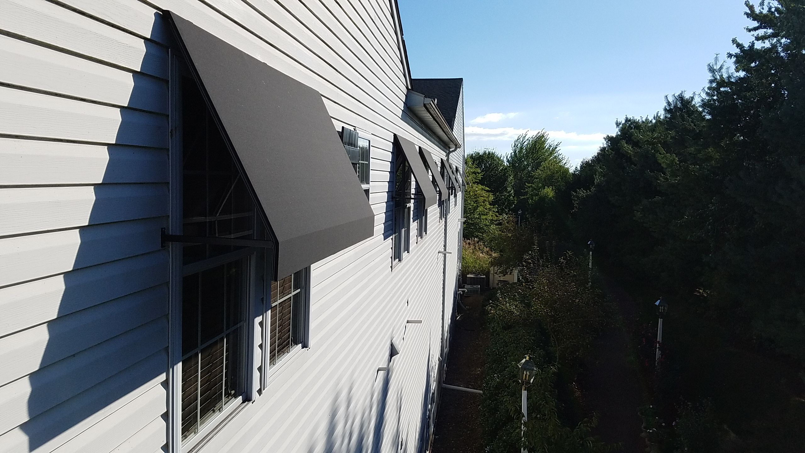 Lower In House Temperatures And Save On Air Conditioning Costs By Installing Window Awnings Open Wing Design Still B Window Awnings Window Installation Awning