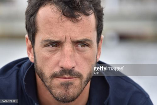 French skipper Louis Burton looks on as he sails his Imoca... #saintpierrelapalud: French skipper Louis Burton looks… #saintpierrelapalud