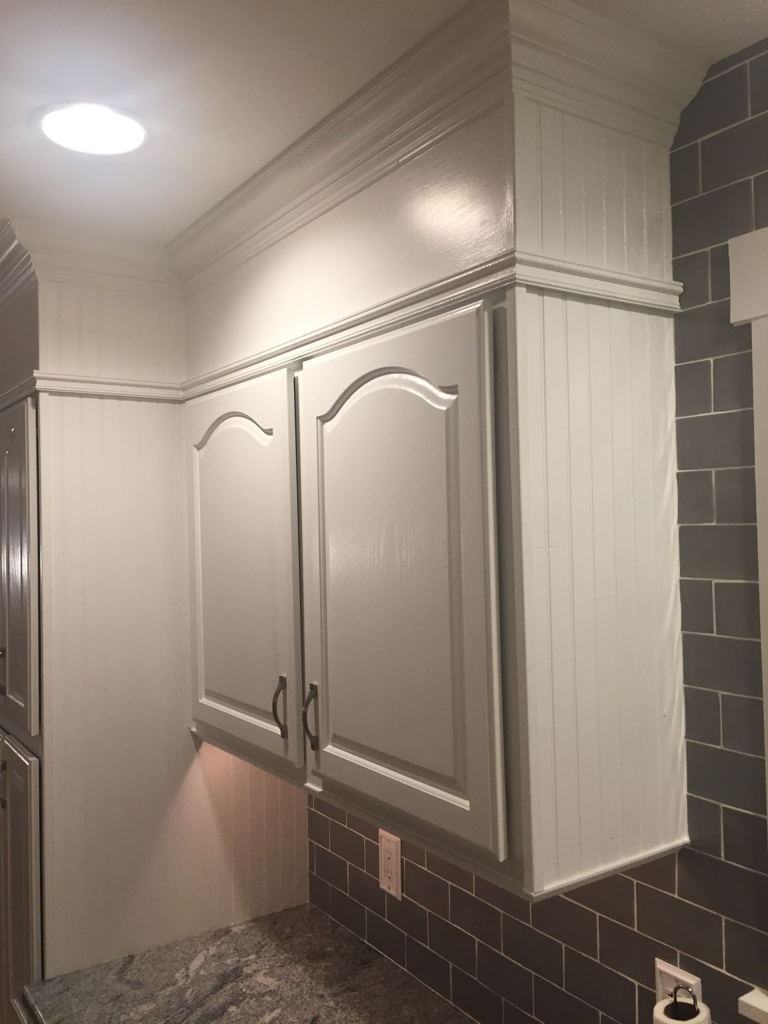 Wood Soffit Adding To Kitchen Cabinets With Wainscoting In