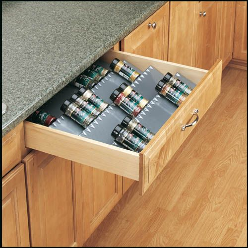 """Rev-A-Shelf ST50-21A-52   Keep spices conveniently stored in a drawer by the stove with Rev-A-Shelf's Universal Spice Trays. With a tiered configuration for total organization and easy access, the Universal Spice Tray is available in a 50"""" x 20"""" size that can be trimmed for a perfect fit in any drawer. The ST50 Series is offered in glossy or textured finish and white or almond colors."""