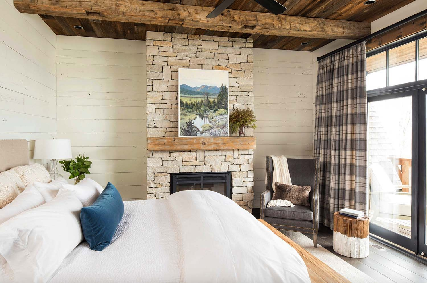 Master bedroom feature wall  Rustic lakeside retreat in Wisconsin features inviting design