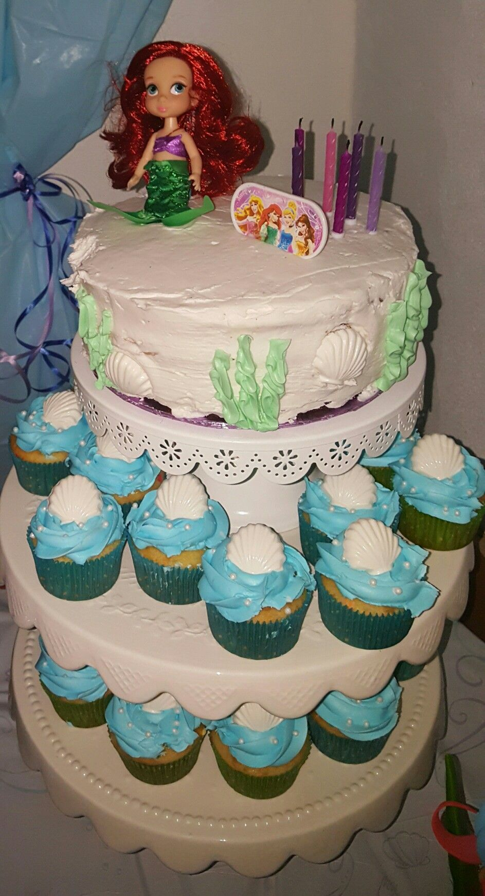 Cake with dollar tree candles and ariel doll from disney