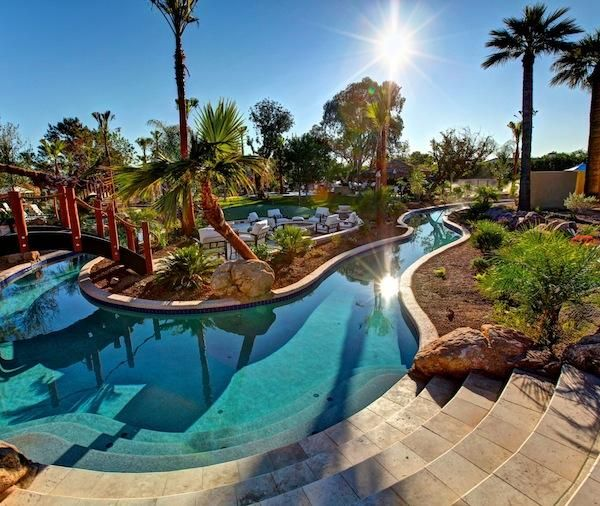 Paradise valley estate with lazy river pool in backyard for Pool designs for large backyards