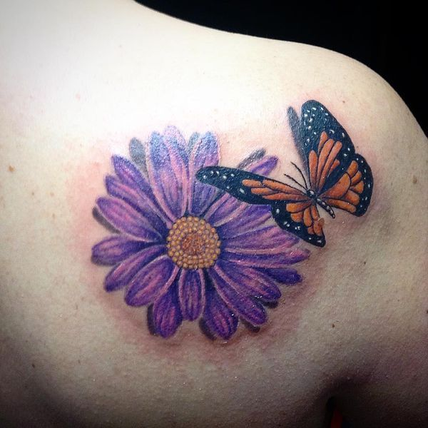 4548d64c4 The purple daisy and butterfly tattoo on the shoulder   flowers ...
