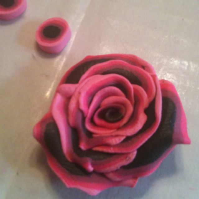 Going to be the center of a bow or necklace  Skulpey rose  Www.carisuniquedesigns.tk coffin purses and more