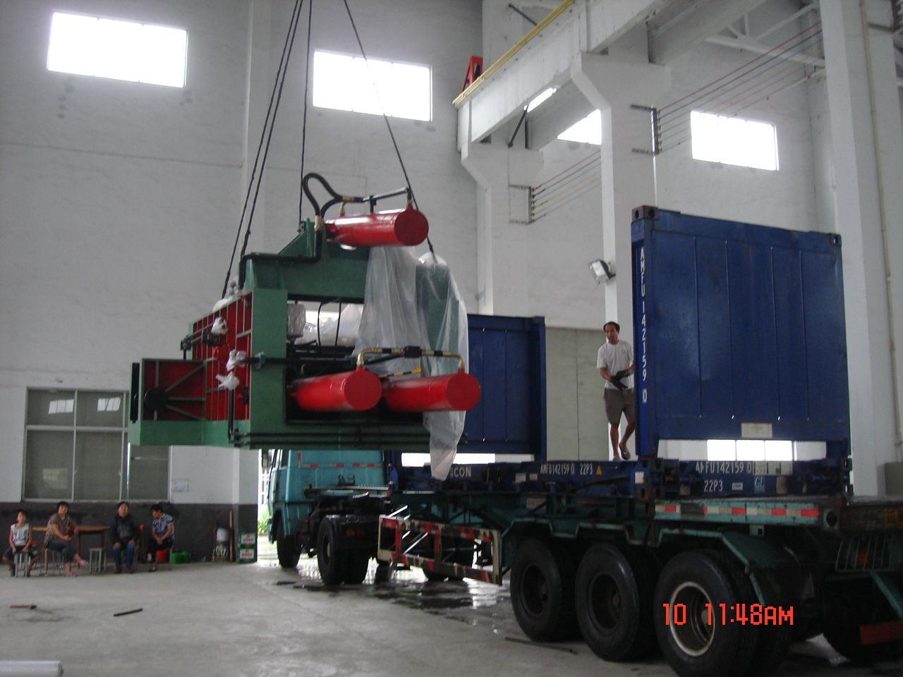 Baling press putting in container Baling, Scrap