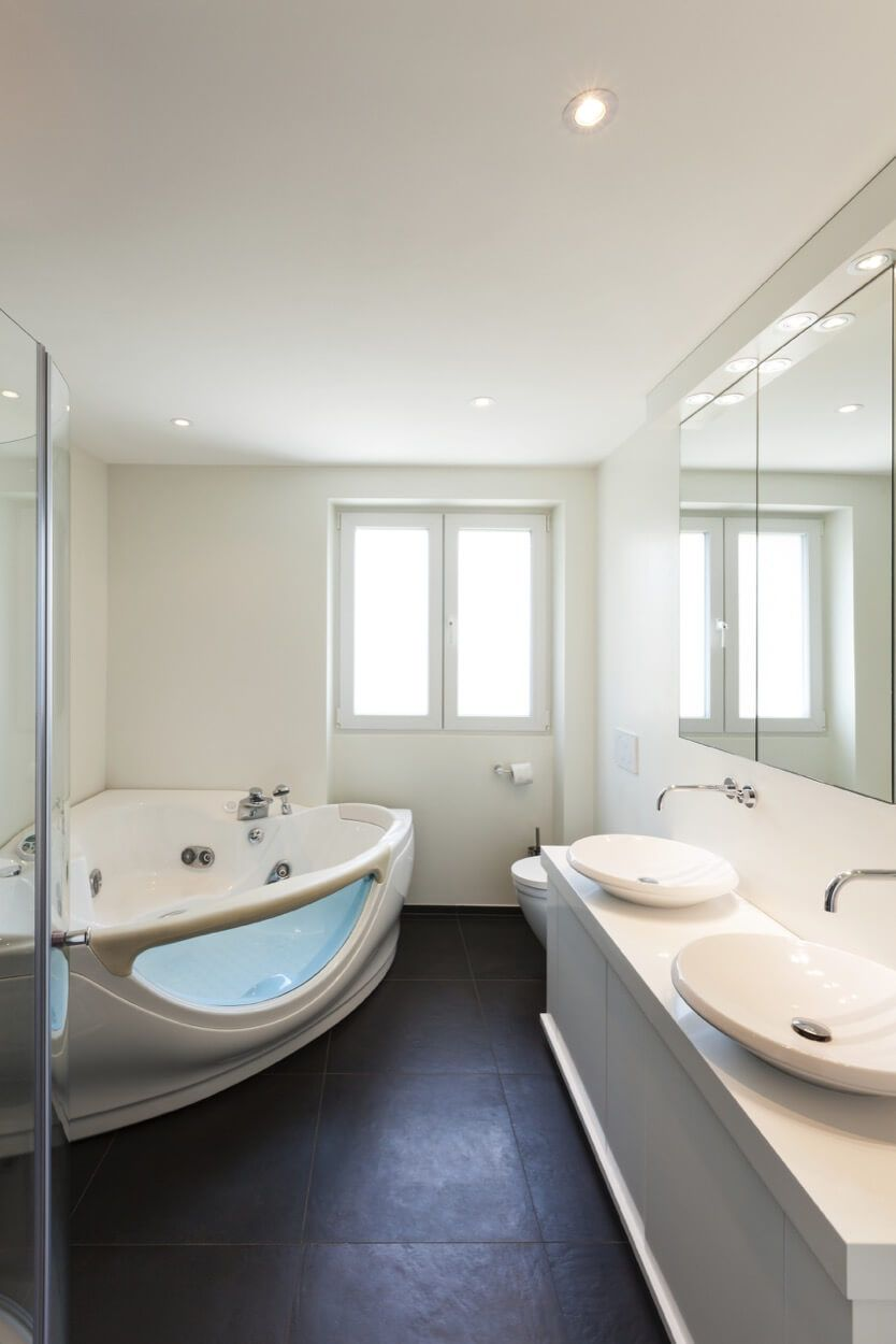 Large Corner Soaking Tub With Glass Design Element | Renovate Your ...