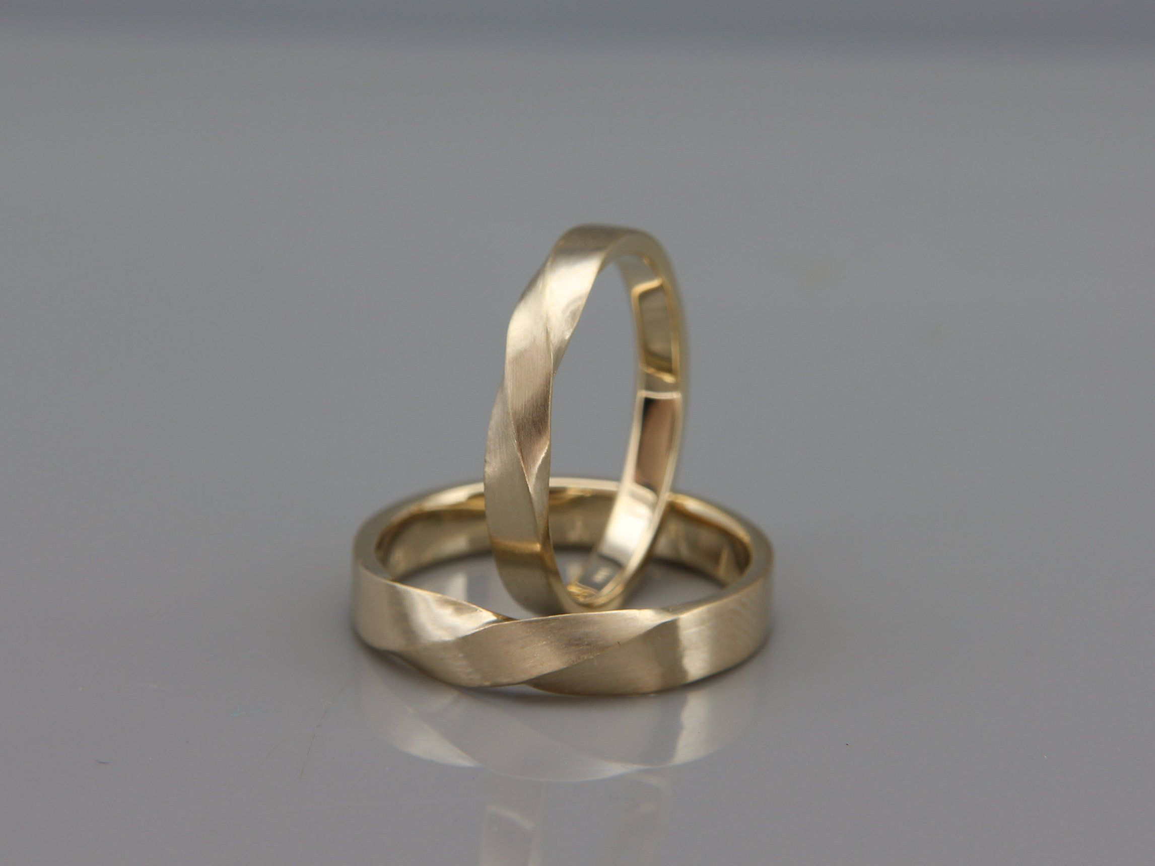 Gold Mubius Rings His and Hers Mobius Wedding Bands set
