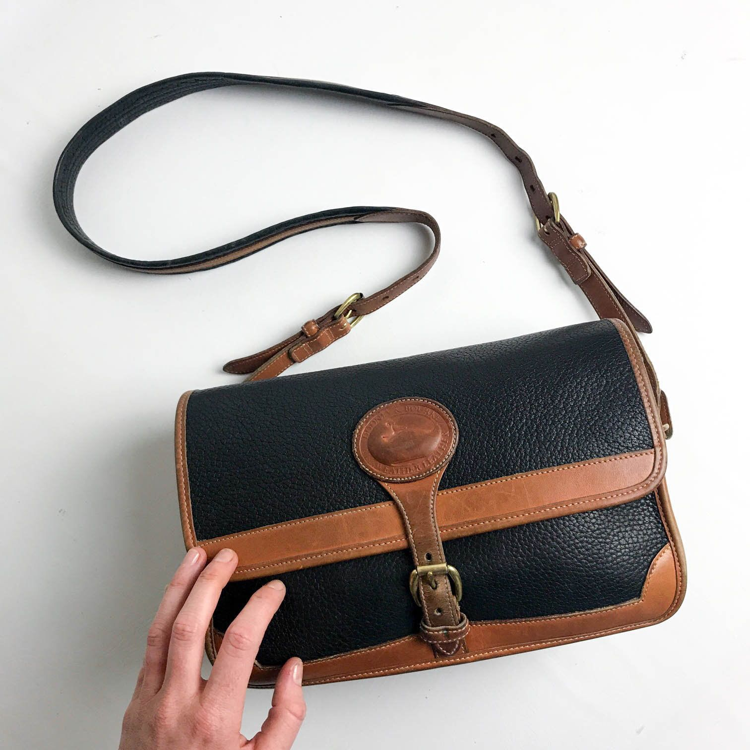 06554b624a8a 90s Vintage Dooney and Bourke Black and Brown Pebbled Leather Crossbody Bag