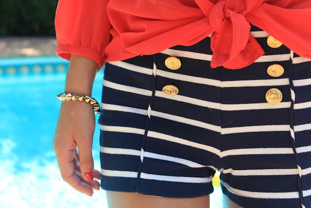 Sailor shorts with gold button accents.