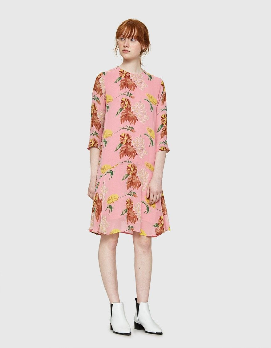 4afa1d09c883 Shift dress from Ganni in Sea Pink. Allover floral print. Round neckline. Concealed  back zip closure. Sheer three-quarter sleeves. Curved ruffle hem. Lined.