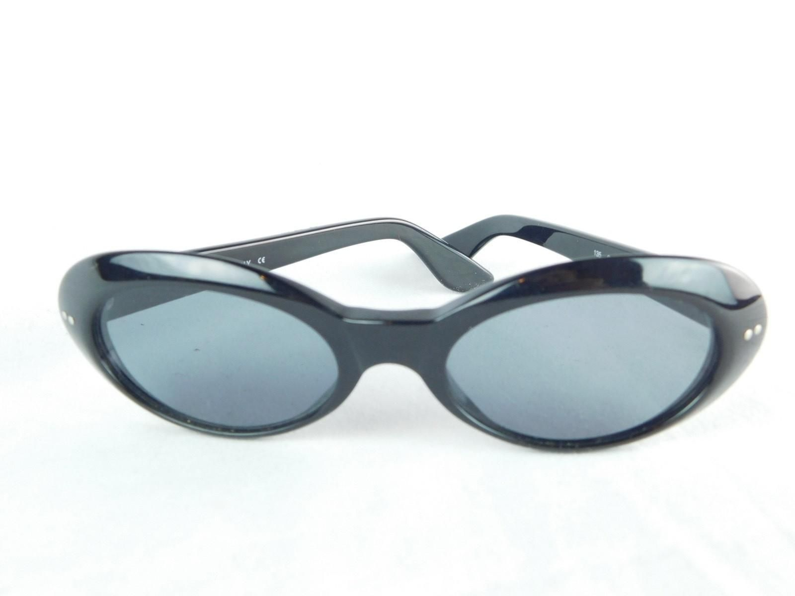ae06d1629c Gucci Oval Black CatEye Sunglasses. Free shipping and guaranteed  authenticity on Gucci Oval Black CatEye