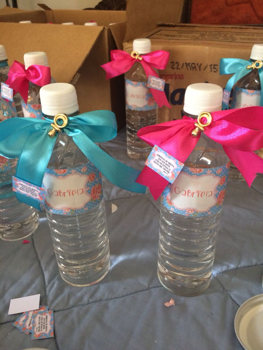 Bottle of water decoration.. Babyshower pink and blue... Baby shower team#bow #bottle #water #bottlewater #waterbottle #babyshower #party #pinkandblue #blueandpick #diy #babygirl  #babyshoweridea #baby #shower #birthday #roses #details #handmade #customize