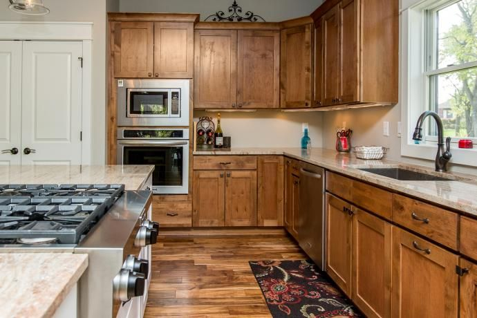 Knotty alder cabinets, Millenium granite | Home kitchens ...