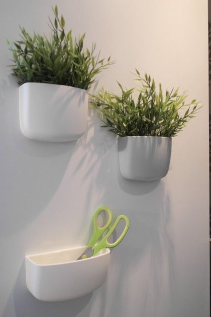 "Normann copenhagen--these easy-to-hang ""folders"" come in a variety of shapes and colors. My favorite part--they can be used for anything from keeping kitchen essentials in an easy to reach spot to planting succulents or other blooms (out of reach of pet interference-- dog OR cat-- no easy feat around here)."