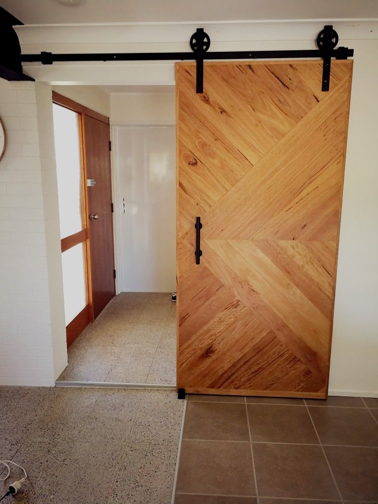 Herringbone Feature Timber Barn Door On Exposed Black Barn Door Rail Australian Blackbutt Timber Tall Cabinet Storage Black Barn Barn Door