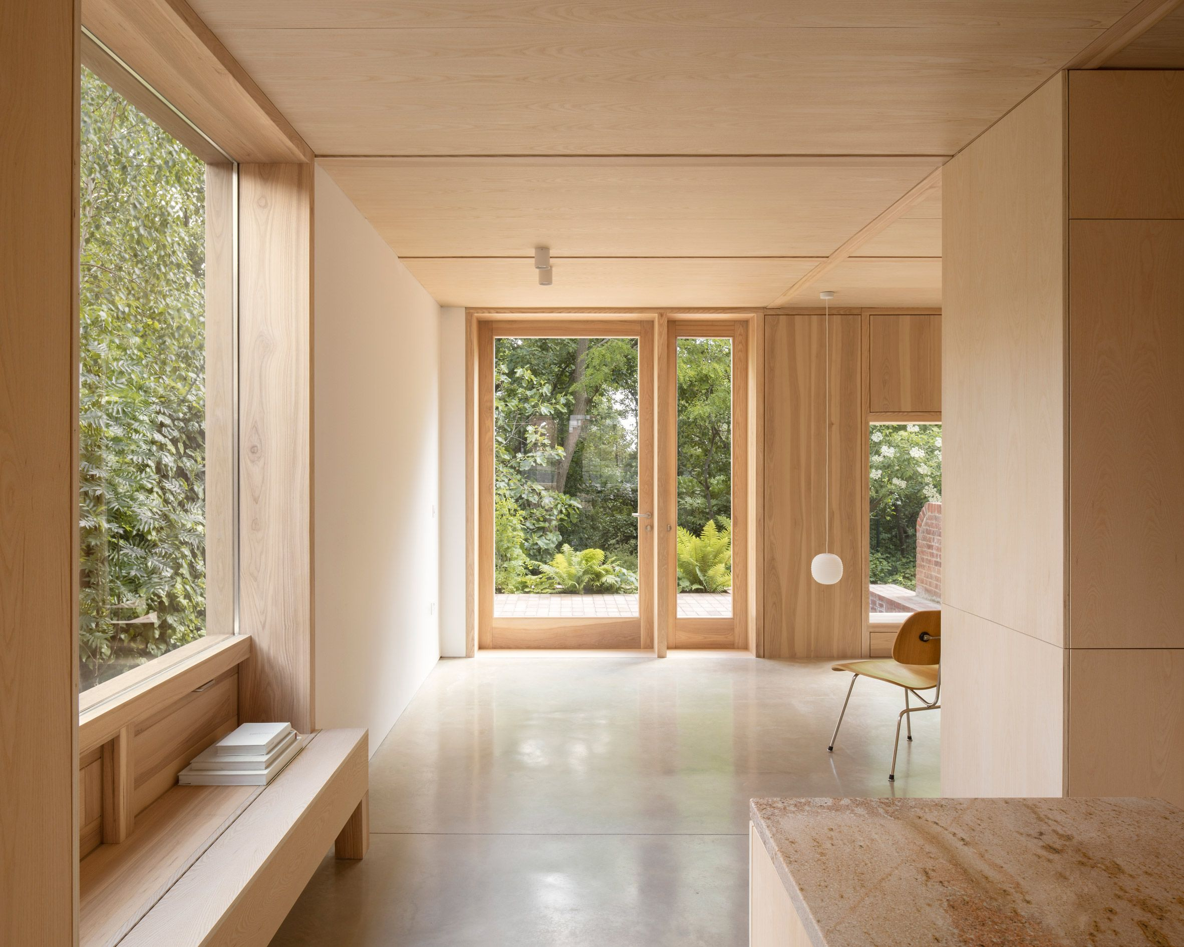 Grove Park is a wood-lined house by O'Sullivan Skoufoglou Architects