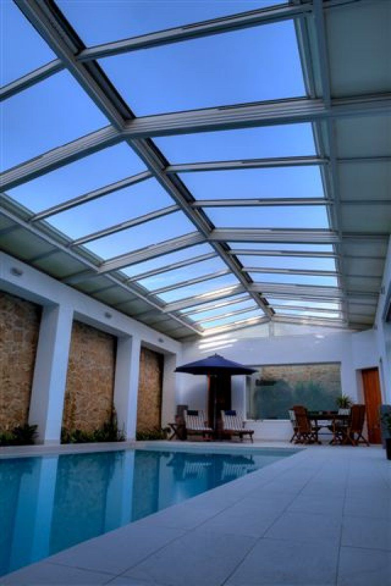 This Retractable Roofing System Over A Private Residential Pool Is A Double Pitch Featuring 2 12 Bays The Pool Cover Residential Pool Architecture Pool Cover