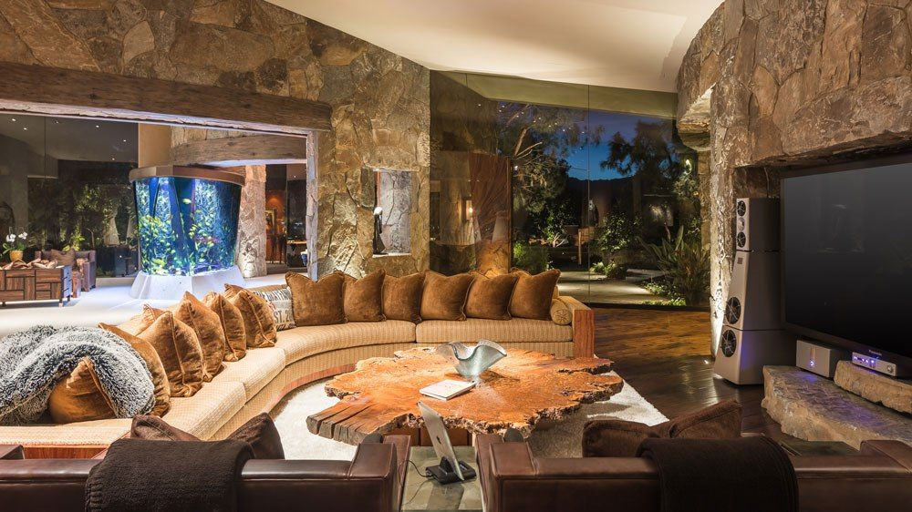 Living Space With A Big Screen T V And A Large Communal Couch Expensive Houses Home Luxury Neighborhoods