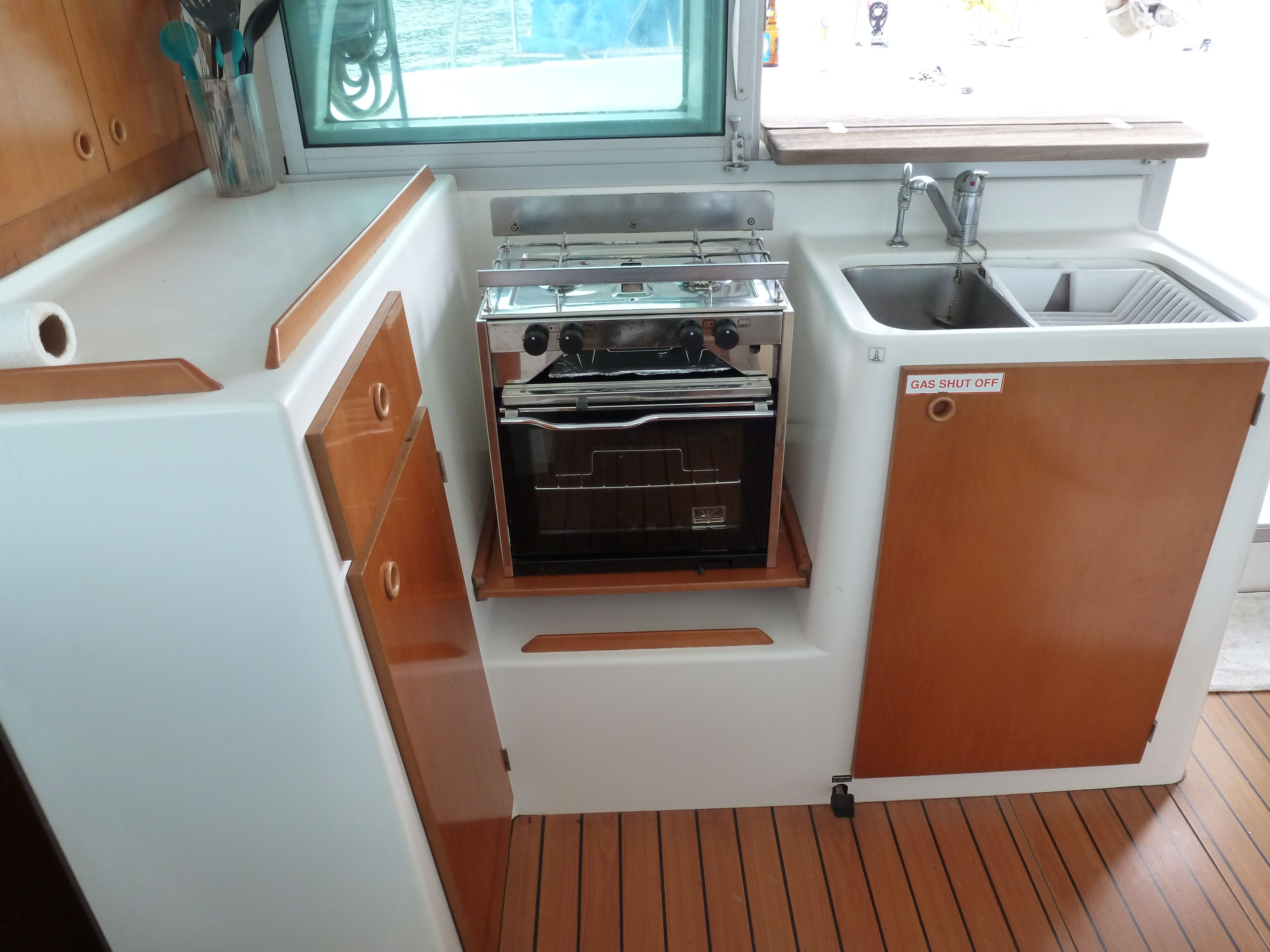 Lagoon 380 galley catamaran galleys or yacht interiors for Galley kitchen cabinets for sale