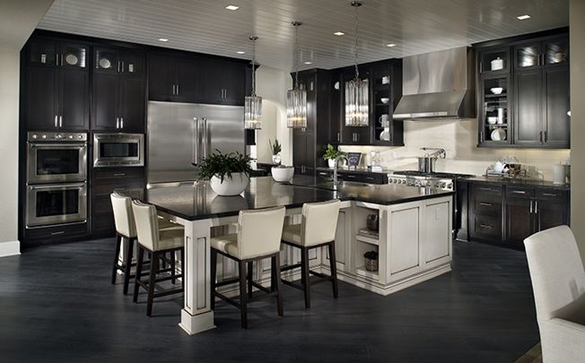 This Gourmet Kitchen With Peninsula Center Island Is A Chef's Best Walk Through Dining Room Design Inspiration