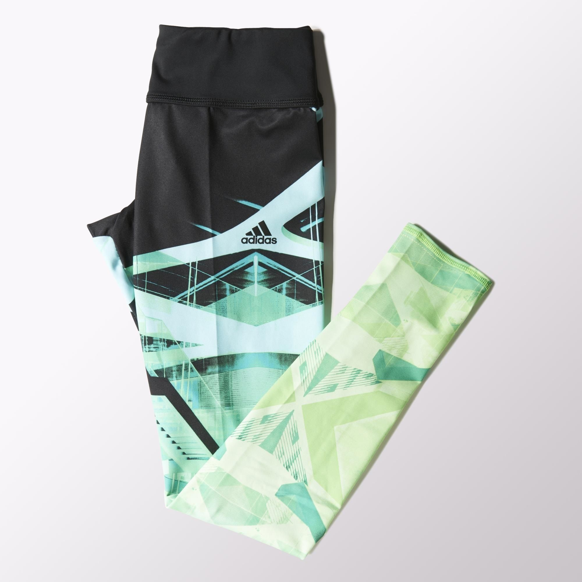 The bold graphic print on these women's adidas Studio Power Laces Tights is inspired by modern architecture, with floating walkways and staircases that create interesting geometric patterns across the legs. The training tights are made of stretchy climalite® fabric that pulls sweat away from skin and through the garment for fast evaporation, leaving you dry and comfortable. Built with a wide elastic waist and reflective details.