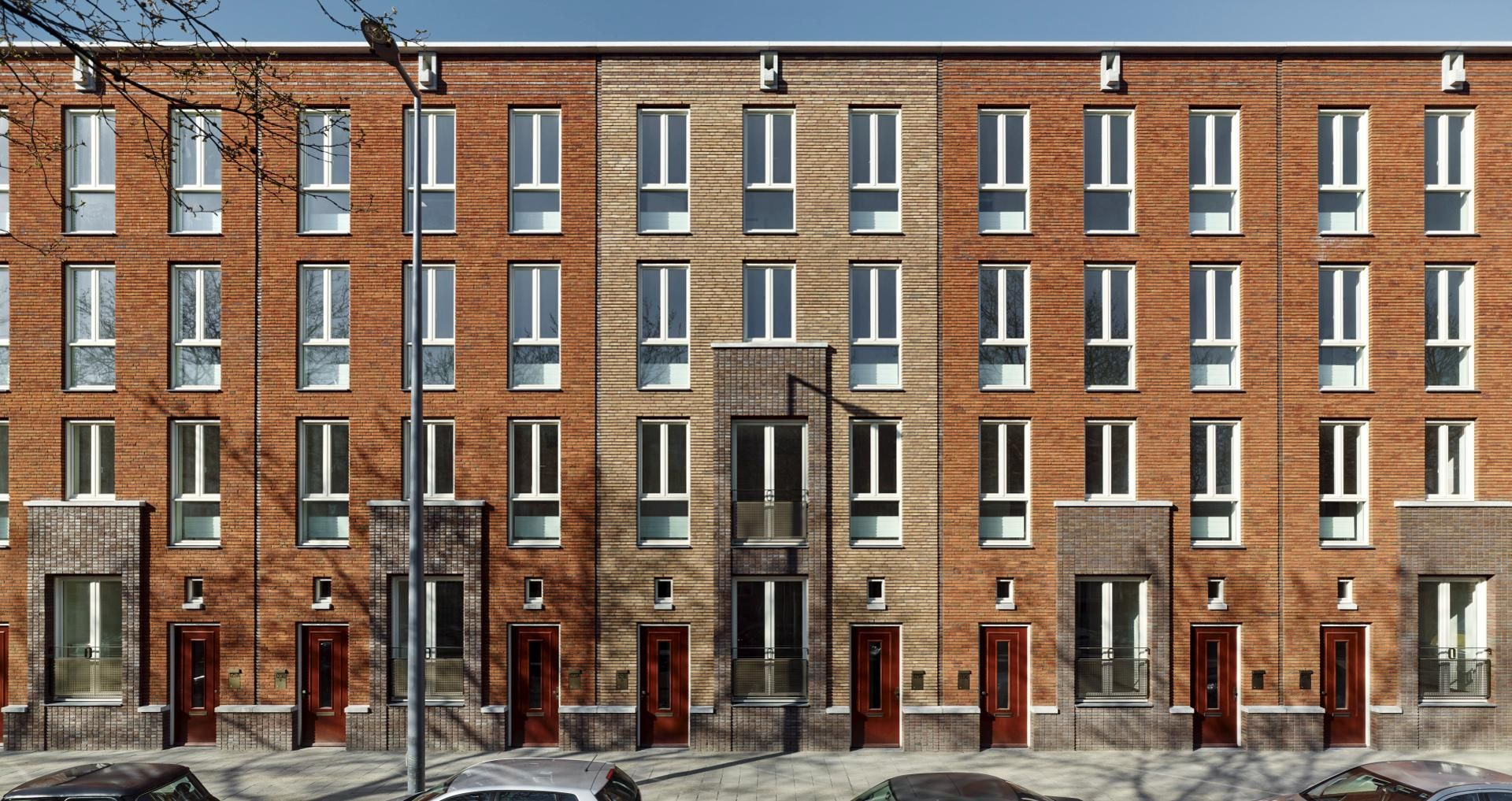 brick facade apartment buildings front view houses with 2 doors