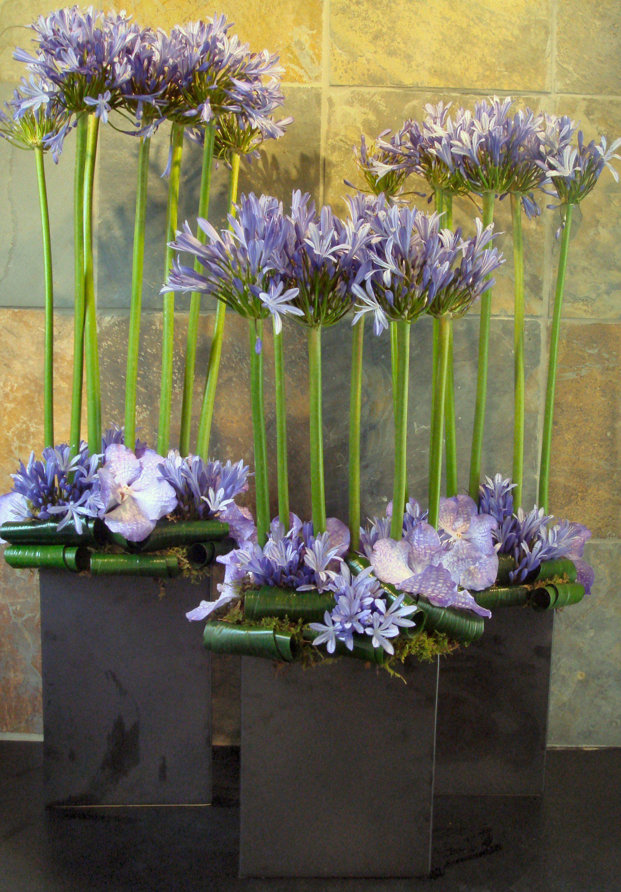 Lavender Modern Flower Arrangement Featuring Vanda Orchids And Allium For A Hotel Lobby Modern Flower Arrangements Hotel Flowers Church Flower Arrangements