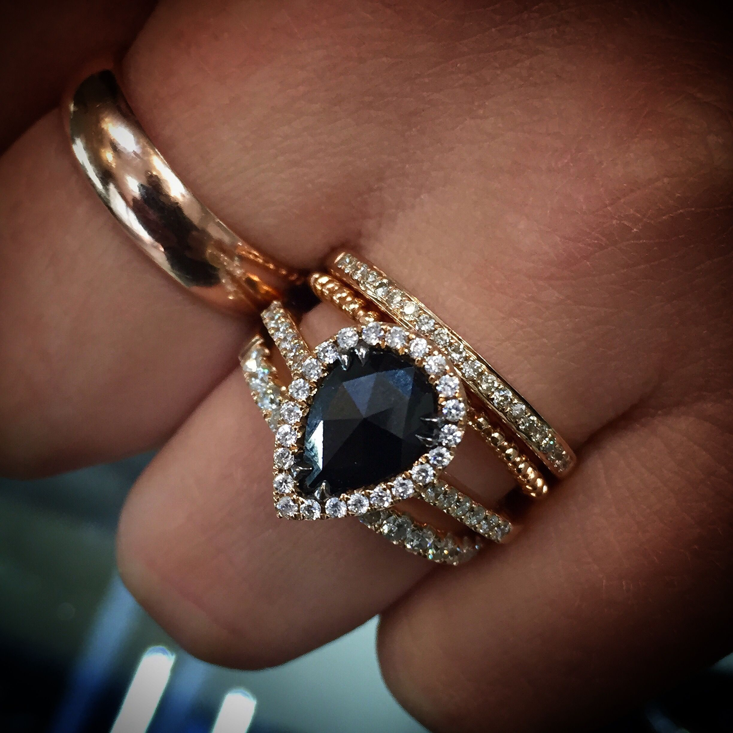 A single rose cut pear shape black diamond weighing carat sits