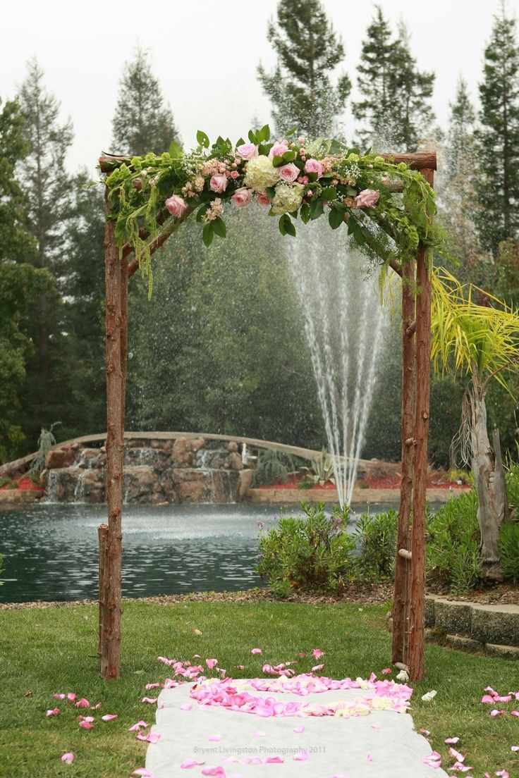 Wedding Flowers Ideas Outdoor Rustic Arch Design Matched With Natural Tree Stem Pillar And Beautiful Pink Flower Arrangements