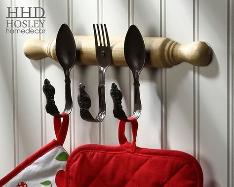 I like this idea except instead of mounting the fork & spoons to a rolling pin I'd mount them to the wall(or a piece of wood) and use the bent fork/spoons as the rolling pin holder.