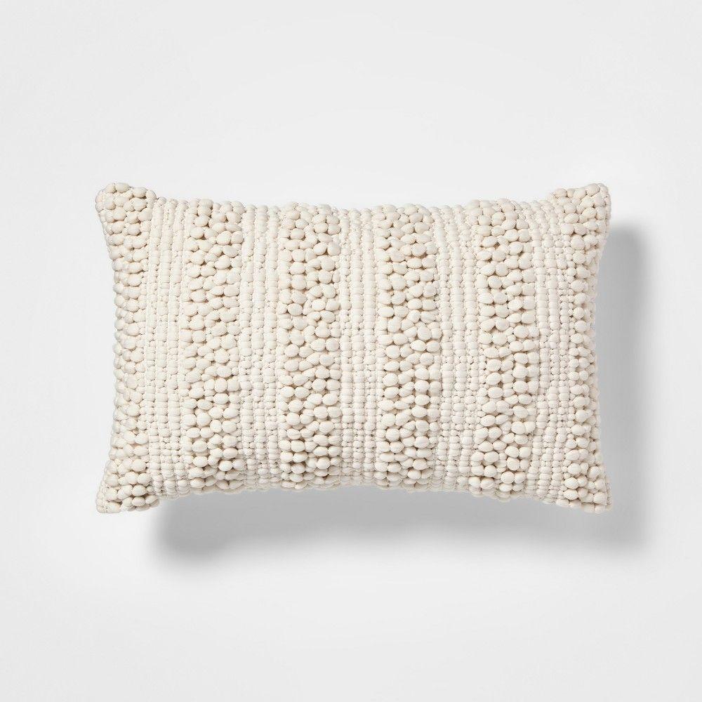 cream textured pom lumbar pillow
