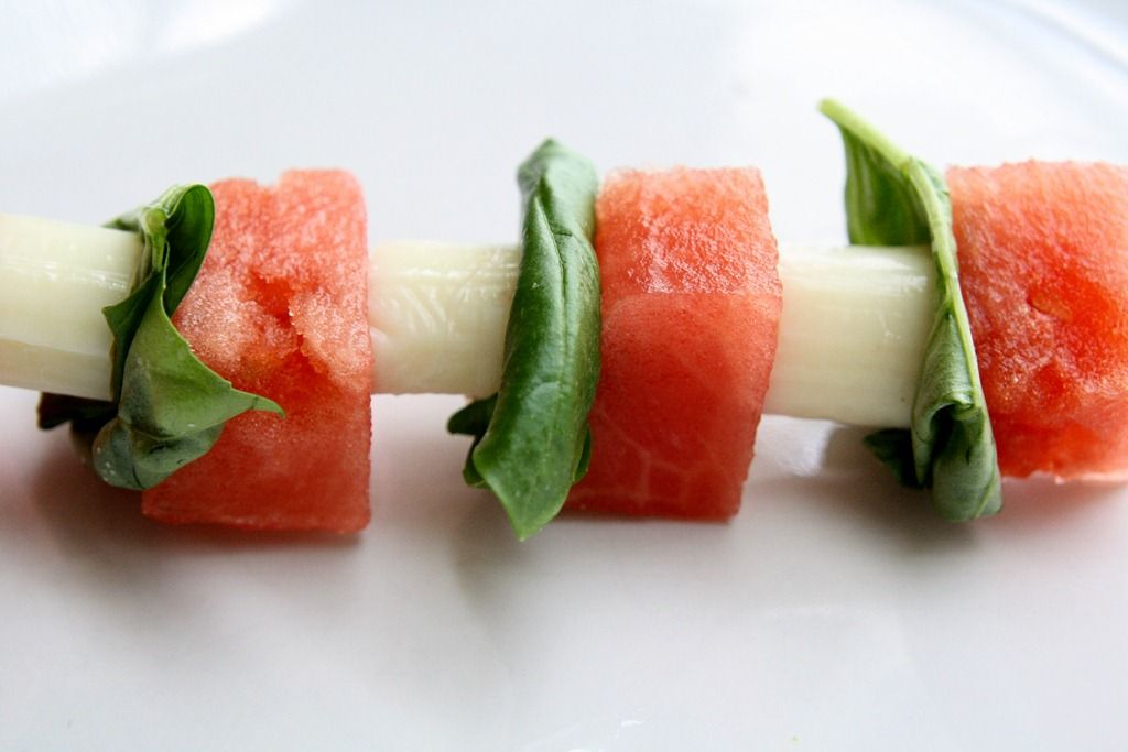 Watermelon, basil and cheese on a toothpick. Might even add balsamic glaze for a sweet kick.